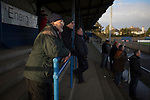 A home supporter watching the first-half action from the covered terracing behind the goal at Links Park. It was Edinburgh City's first Scottish League visit to Montrose since the club were promoted from the Lowland League the previous season. City won the match 1-0 to record their first league win of the season, captain Dougie Gair scoring the winner from the penalty spot in the 68th minute in a match watched by 388 spectators.