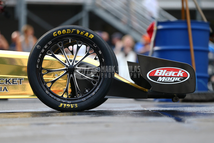 Jun 19, 2015; Bristol, TN, USA; Detailed view of the wheels and front wing on the NHRA top fuel dragster of driver Leah Pritchett during qualifying for the Thunder Valley Nationals at Bristol Dragway. Mandatory Credit: Mark J. Rebilas-