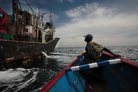Out with canoe fishermen.  Guy in the prow of the boat (many photographs) is:  Abdou Sall +221 551 90 11.Rue 59X68 Medina.Dakar Senegal..Fishermen coming in and out of port at Dakar, Senegal.  Everyone we talked to said the fishing was very poor compared to other years and that they were getting very few fish.