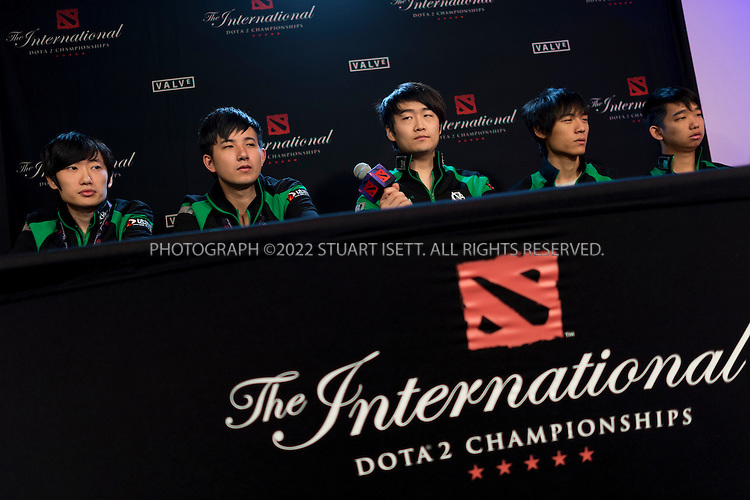 7/21/2014&mdash;Seattle, WA, USA<br /> <br /> Here: &lsquo;Vici Gaming&rdquo;, a DOTA 2 team from China, speaking at a press conference before the final against &ldquo;Newbee&rdquo;, another team from China. Vici Gaming lost the best of five final, 3 games to 1.<br /> <br /> <br /> &quot;The International&quot; is a video-game tournament hosted by Valve, a game maker based in Bellevue, WASH., with a prize pool reaching $10.8 million. this year the event was held at Key Arena in Seattle, WASH.<br /> <br /> Contestants were playing Dota 2, a 2013 multiplayer online battle arena video game developed by Valve. Five players are on each team, with teams traveling for around the world to battle at the sold-out event.<br /> <br /> <br /> Photograph by Stuart Isett<br /> &copy;2014 Stuart Isett. All rights reserved.