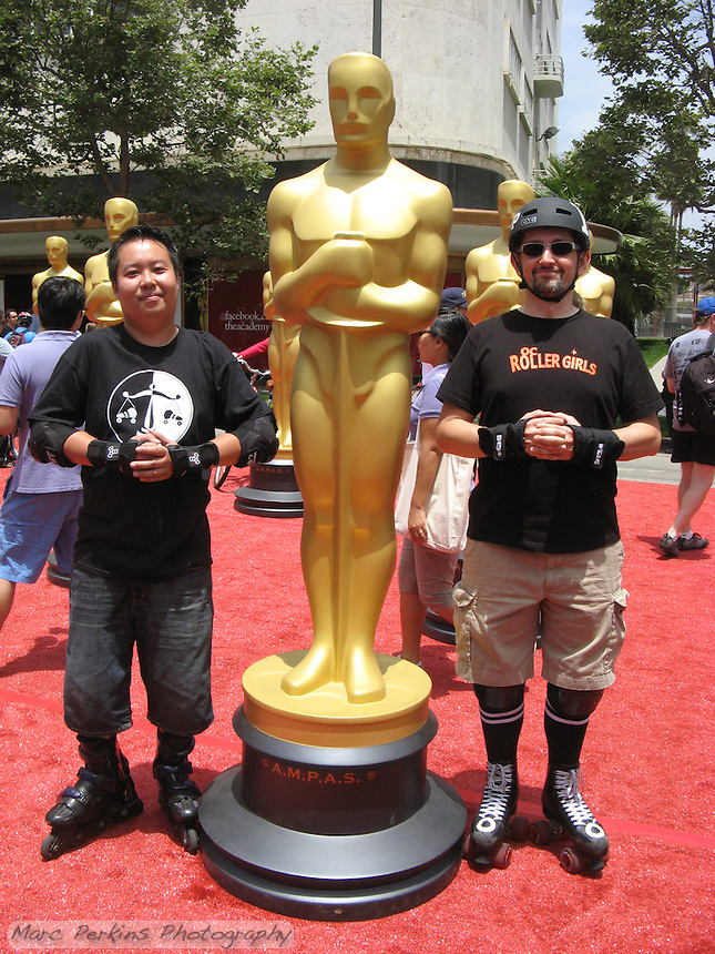George and me on wheels next to the AMPAS Oscar statues, which were set up in the pedestrian zone near LACMA for the June 2013 CicLAvia event.