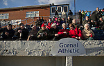 Gornal Athletic 4 Wisbech Town 2, 02/02/2013. Garden Walk Stadium, FA Vase 4th round. Supporters in the seats watching the teams warming up pre-match at Garden Walk Stadium, prior to the FA Vase 4th round tie between Gornal Athletic from Dudley in the West Midlands and visitors Wisbech Town. Gornal, from the Midland Alliance and appearing for the first time at this stage of the tournament, defeated Wisbech, who play in the Eastern Counties League, by 4-2 after extra-time, after the visitors had lead two-nil after 10 minutes. The FA Vase was a nationwide, non-League English football tournament for semi-professional clubs and the winner of this tie played away at Bodmin Town in the next round. Photo by Colin McPherson.
