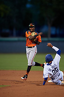 AZL Giants Orange shortstop Marco Luciano (10) throws to first base over Alex De Jesus (25) for a double play during an Arizona League game against the AZL Dodgers Mota on June 29, 2019 at Camelback Ranch in Glendale, Arizona. The AZL Giants Orange defeated the AZL Dodgers Mota 9-3. (Zachary Lucy/Four Seam Images)