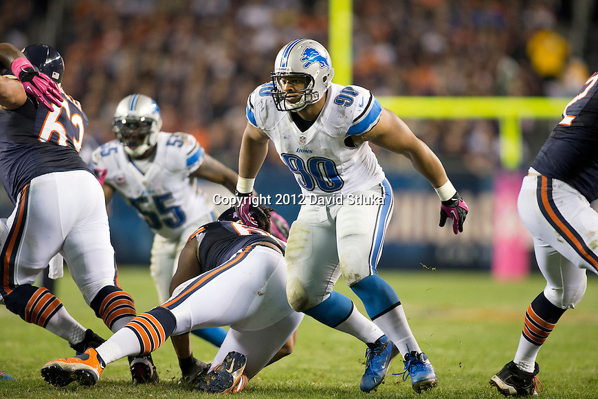 Detroit Lions defensive lineman Ndamukong Suh (90) rushes the quarterback during a Week 7 Monday Night NFL football game against the Chicago Bears Monday, October 22, 2012 in Chicago. The Bears won 13-7. (AP Photo/David Stluka)
