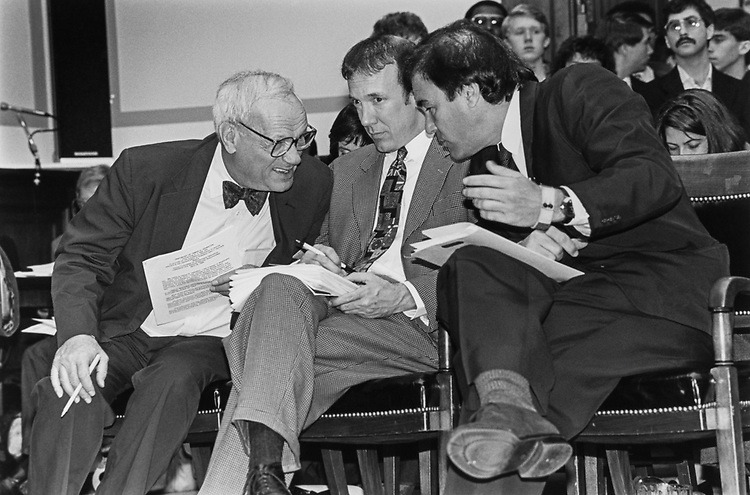 Frank Mankiewicz, Mark robertson and Oliver Stone chat before testimony on April 30, 1992. (Photo by Laura Patterson/CQ Roll Call)