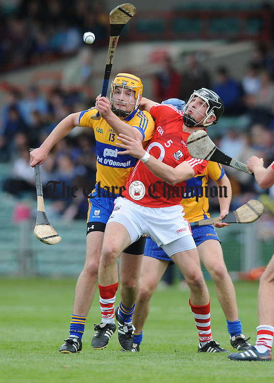 Martin Duggan of Clare in action against Tadhg Healy of Cork during their intermediate championship game at The Gaelic Grounds. Photograph by John Kelly