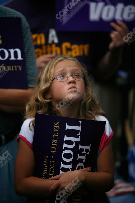 A supporter of former Senator Fred Thompson (R - TN), 2008 Republican candidate for President, listens as he speaks to a crowd about his plans for his Presidency, in front of the Nashua town hall. Nashua, New Hampshire, September 9, 2007.