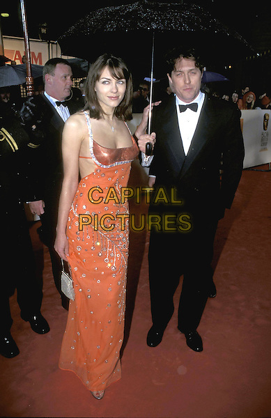 ELIZABETH HURLEY & HUGH GRANT.19 April 1998.full length full-length long orange dress silver sparkly beading .ref:7313.www.capitalpictures.com.sales@capitalpictures.com.©Capital Pictures