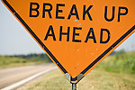 Break Up Ahead--orange traffic hazard sign along the road in rural Nebraska