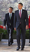 United States President Barack Obama, right, walks out of the Oval Office with Jim Yong Kim, president of Dartmouth College and nominee to become president of the World Bank, to make a speech in the Rose Garden of the White House in Washington, D.C., U.S., on Friday, March 23, 2012. Kim was born in Seoul and is a U.S. citizen. He would succeed Robert Zoellick as the head of the bank. The bank made $57 billion loans in the last fiscal year. .Credit: Andrew Harrer / Pool via CNP