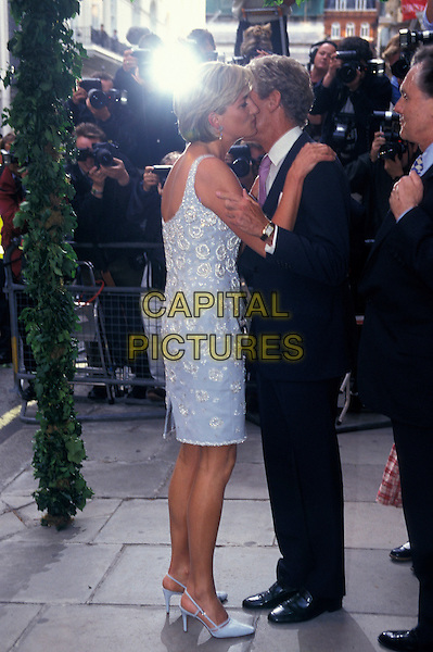 HRH PRINCESS DIANA, THE PRINCESS OF WALES.At Christie's, London , England, 2nd June 1997,.royal Lady Di full length pale blue white beads beaded dress side kissing greeting embracing.CAP/HT.©Hugh Thompson/Capital Pictures