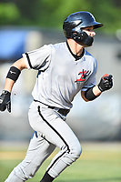 Kannapolis Intimidators center fielder Luis Gonzalez (10) runs to first base during a game against the Asheville Tourists at McCormick Field on May 12, 2018 in Asheville, North Carolina. The Intimidators defeated the Tourists 11-8. (Tony Farlow/Four Seam Images)
