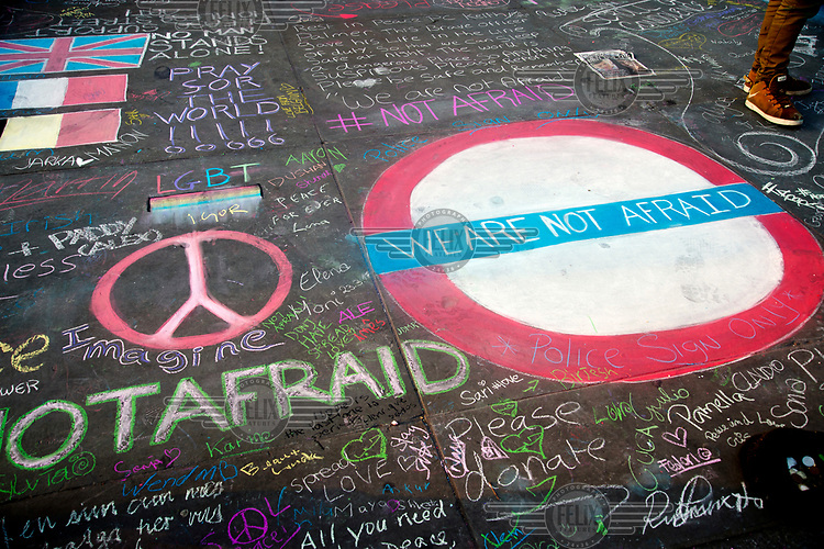 Messages in chalk mostly reading: 'We are not afraid' at a vigil in Trafalgar Square for victims of 22 March 2017 Westminster terror attack.