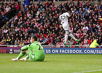 Pictured: Marvin Emnes of Swansea (R) celebrating his goal, making the score 2-0 to Swansea, while Sundreland goalkeeperVito Mannone (L) sits on the ground dejected. Sunday 11 May 2014<br /> Re: Barclay's Premier League, Sunderland v Swansea City FC at the Stadium of Light, Sunderland, UK.