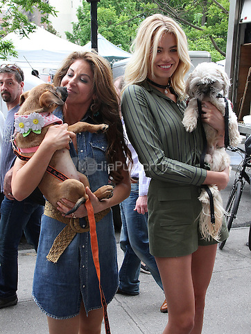 NEW YORK, NY - MAY 14:  Dylan Lauren and model Hailey Clauson, 2016 Sports Illustrated Swimsuit issue cover girl,  at the Dylan's Candy BarN Dog Adoption Event in New York, New York on May 14, 2016.  Photo Credit: Rainmaker Photo/MediaPunch