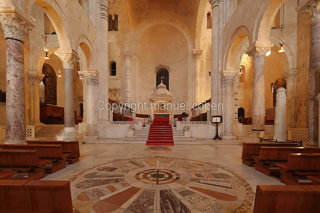 Altar at the front of the nave of Bari Cathedral, built in Romanesque style in the late 12th and early 13th centuries, consecrated 1292 and dedicated to St Sabinus, bishop of Canosa, in Bari, Puglia, Italy. The nave has 3 aisles separated by a Romanesque colonnade. Picture by Manuel Cohen
