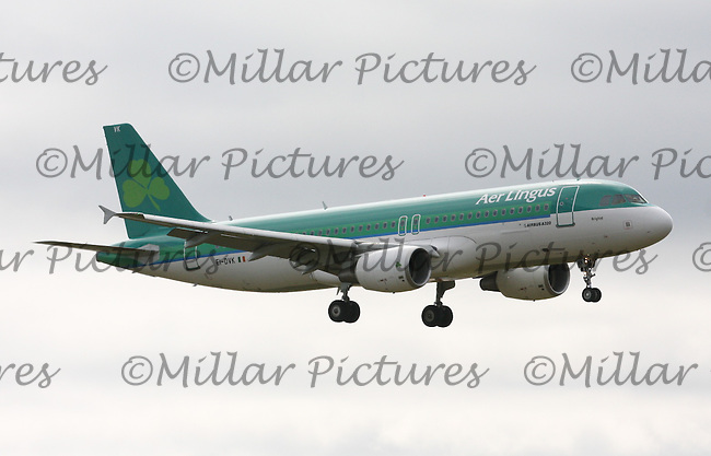 An Aer Lingus Airbus A320-214 Registration EI-DVK named Brighid landing at London Heathrow Airport on 29.5.11.