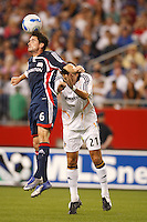 New England Revolution defender (6) Jay Heaps heads the ball over Los Angeles Galaxy forward (21) Alan Gordon. The New England Revolution defeated the Los Angeles Galaxy  1-0 during an MLS regular season match at Gillette Stadium, Foxborough, MA, on August 12, 2007.