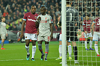 Michail Antonio of West Ham United watches over Sadio Mane of Liverpool during West Ham United vs Liverpool, Premier League Football at The London Stadium on 4th February 2019