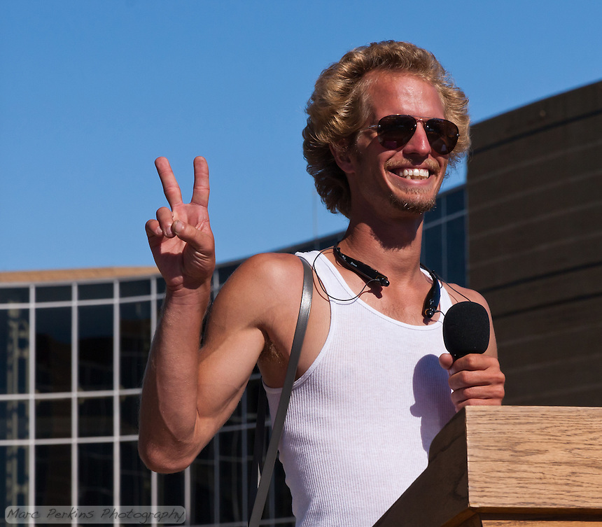 """""""Web"""" (Andrew) mugs for the cameras after discussing marching safety procedures before the Occupy Orange County, Irvine march on November 5."""