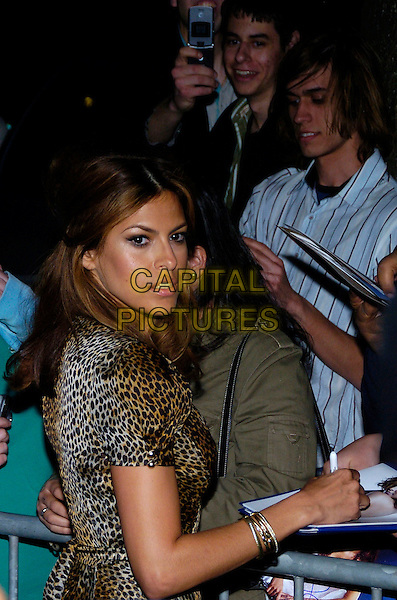"EVA MENDES.6th Annual Tribeca Film Festival - Cadilac: ""Live!"" after party at Underbar, New York City, New York, USA,.28 April 2007..half length leopard print wrap maxi dress signing autographs.CAP/ADM/BL.©Bill Lyons/AdMedia/Capital Pictures. *** Local Caption ***"