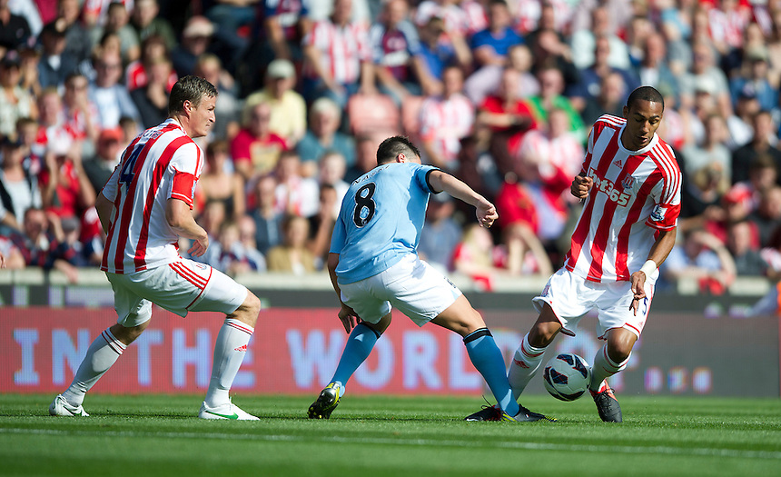 Stoke City's Steven N'Zonzi and Manchester City's Samir Nasri ..Football - Barclays Premiership - Stoke City v Manchester City - Saturday 15th September 2012 - Britannia Stadium - Stoke..