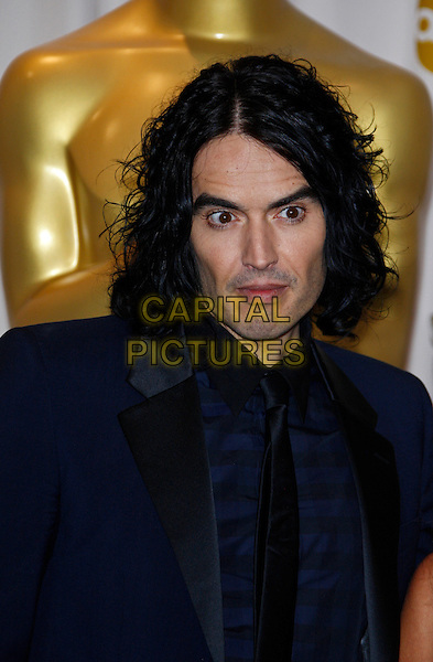 RUSSELL BRAND.83rd Annual Academy Awards - Oscars.Kodak Theatre, Hollywood, CA, USA..February 27th, 2011 .Pressroom press room winner trophy headshot portrait navy blue jacket tie black.CAP/PE.©Peter Eden/Capital Pictures.