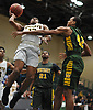 Danny Ashley #12 of Uniondale, left, drives to the net as Tyreik Frazier #42 of Westbury contests his shot during the Nassau County varsity boys basketball Class AA semifinals at Farmingdale State College on Monday, Feb. 26, 2018. Ashley scored 15 points in top-seeded Uniondale's 61-44 win.