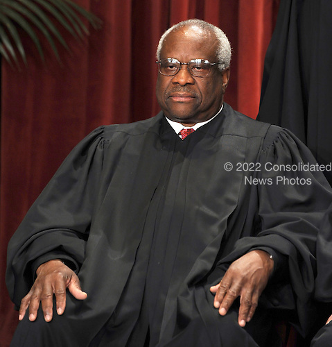 Associate Justice Clarence Thomas and the Supreme Court Justices of the United States sit for a formal group photo in the East Conference Room of the Supreme Court in Washington on Friday, October 8, 2010.    .Credit: Roger L. Wollenberg - Pool via CNP