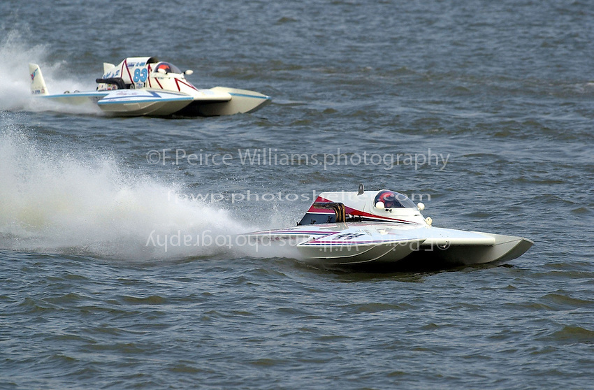 "Tony Stalder, GNH-83 ""Blue Mule II and Ken Brodie, II, GNH-44, Grand National Hydroplanes.Rising Sun Regatta, Ohio River, Rising Sun, IN, USA 8-9 September,2001.Copyright©F.Peirce Williams 2001..F. Peirce Williams .photography.P.O.Box 455  Eaton, OH 45320 USA.p: 317.358.7326  e: fpwp@mac.com"