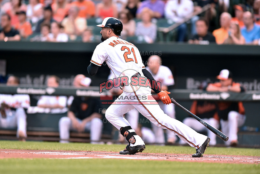 Baltimore Orioles right fielder Nick Markakis #21 swings at a pitch during a game against the New York Yankees at Oriole Park at Camden Yards August 11, 2014 in Baltimore, Maryland. The Orioles defeated the Yankees 11-3. (Tony Farlow/Four Seam Images)