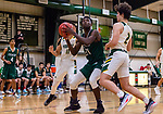 WATERBURY, CT. 11 January 2020-011120BS52 - Chase Collegiate's Jamal Clarke (21), center, looks to make move down low in the paint against the double team defense of Forman's Lorenzo Lauria (11), left, and Ben Rushford (2), right, during a Boys Prep School Basketball game between Forman and Chase Collegiate at Chase Collegiate in Waterbury on Saturday. Chase was beaten in overtime by Forman 73-68. Bill Shettle Republican-American