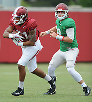 NWA Democrat-Gazette/ANDY SHUPE<br /> Arkansas quarterback Austin Allen (right) hands the ball off to running back Devwah Whaley Tuesday, Aug. 1, 2017, during practice at the university's practice field in Fayetteville. Visit nwadg.com/photos to see more photographs from the day's practice.