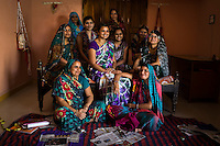 Stitching teacher Kavita Yadav (centre), 34, who is hired using the Fairtrade Premiums to teach women sewing, poses for a portrait with her students in Maheshwar, Khargone, Madhya Pradesh, India on 13 November 2014. Kavita travels to a different village every few weeks to conduct the stitching course that is free for women, as she is funded using the Fairtrade Premiums from Fairtrade cotton farmers. Photo by Suzanne Lee for Fairtrade