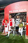 Nederland, Amsterdam, 3 november 2012.Eredivisie.Seizoen 2012-2013.Ajax-Vitesse (0-2).Theo Janssen (r.) van Vitesse betreed het veld. Links Christian Eriksen van Ajax.