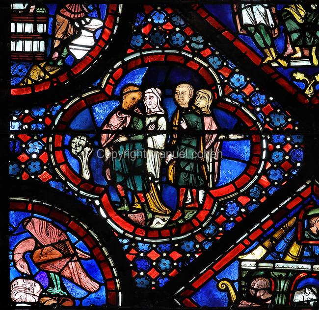 Noah and his family finding a vine and discussing planting the first vineyard, from the discovery of the vine, from the Life of Noah stained glass window, 13th century, in the nave of Chartres cathedral, Eure-et-Loir, France. Chartres cathedral was built 1194-1250 and is a fine example of Gothic architecture. Most of its windows date from 1205-40 although a few earlier 12th century examples are also intact. It was declared a UNESCO World Heritage Site in 1979. Picture by Manuel Cohen