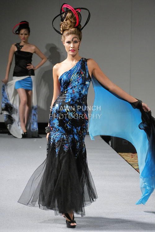 Model walks the runway in an outfit from Sushma Patel Fall 2012 collection, during Couture Fashion Week New York, February 17, 2012.