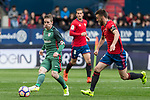 Iker Muniain of Athletic Club competes for the ball with Oier Sanjurjo of Club Atletico Osasuna during the match of  La Liga between Club Atletico Osasuna and Athletic Club Bilbao at El Sadar Stadium  in Pamplona, Spain. April 01, 2017. (ALTERPHOTOS / Rodrigo Jimenez)