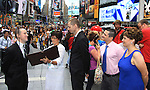 Damon Jacobs and Kayla (R) with As The World Turns' Colleen Zenk is ordained Universal Life Church minister who officiated the wedding of We Love Soaps Kevin Mulcahy Jr and Roger Newcomb on August 18, 2012 in Times Square, New York City, New York. (Photos by Sue Coflin/Max Photos)