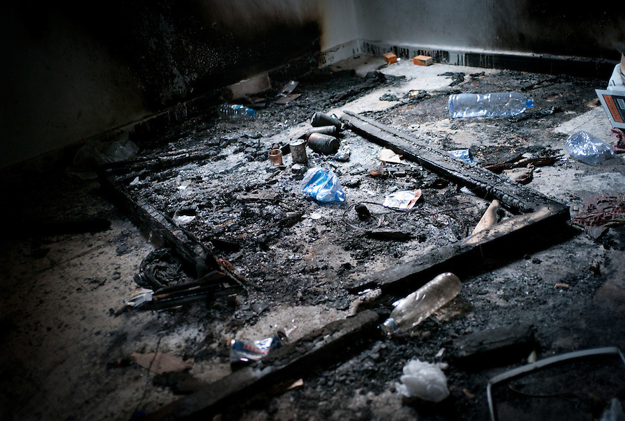 A burned portrait of Gaddafi on the floor of the special police headquarters in Tobruk, LIbya.