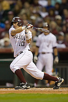Kevin Gonzalez #10 of the Texas A&M Aggies follows through on his swing versus the Rice Owls in the 2009 Houston College Classic at Minute Maid Park February 28, 2009 in Houston, TX.  The Owls defeated the Aggies 2-0. (Photo by Brian Westerholt / Four Seam Images)