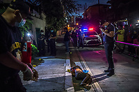 "MANILA, PHILIPPINES - OCTOBER 1: Scene of the crime police investigators, SOCO, examine the body of a man, a summary execution victim, found dumped on the side of the road with his hands tied around his back and his head wrapped in packaging tape, in Sampaloc on October 1, 2016 in Manila, Philippines. A piece of paper was found attached around the victim's neck with a message: ""Tulak na ayaw magpapigil, buhay ay titigil (A pusher who won't stop will have his life ended)."" Such messages are often found attached to the bodies of those killed in summary executions, unofficial murders that the government claims they have nothing to do with. They are a warning, left by supposed vigilantes, to strike fear into those who would use or sell drugs.<br /> Photo by Daniel Berehulak for The New York Times"