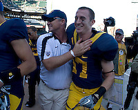 California head coach Jeff Tedford hugs his son, Quinn Tedford after winning 75th victory during his CAL coaching career at AT&T Park in San Francisco on September 17th, 2011.  California defeated Presbyterian, 63-12.