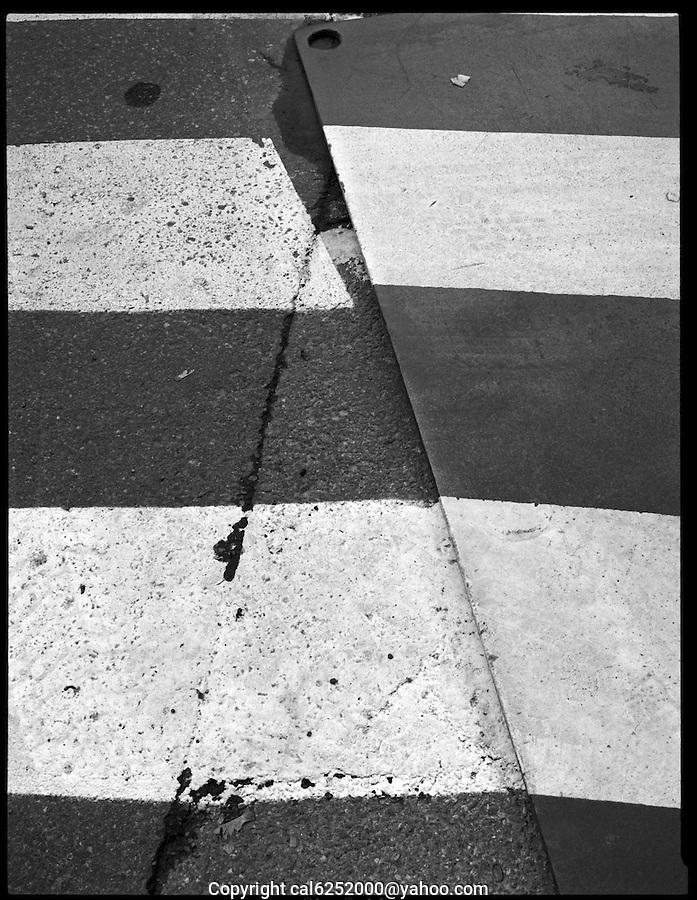 White lines on metal and asphalt