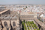 View from La Giralda over the Patio de los Naranjos and roofs of the cathedral towards La Maestranza and the Triana quarter in Seville,Spain.