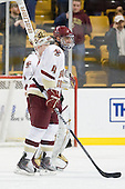 John Muse (BC - 1), Tommy Cross (BC - 4) - The Boston College Eagles defeated the Boston University Terriers 3-2 (OT) in their Beanpot opener on Monday, February 7, 2011, at TD Garden in Boston, Massachusetts.