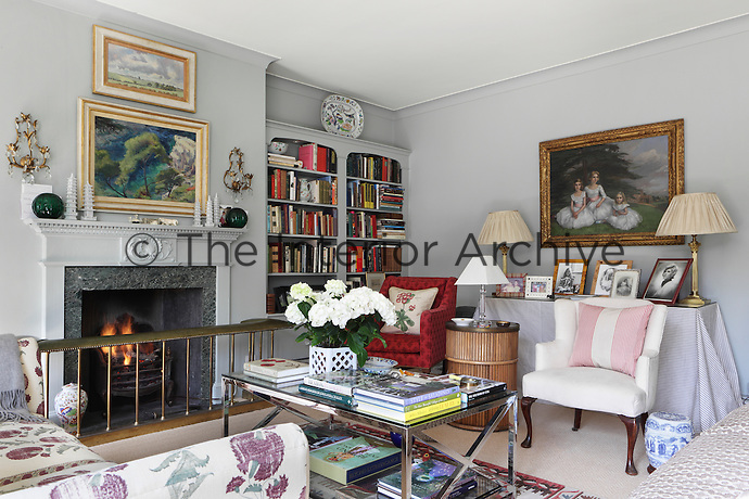 The airy sitting room, painted in grey and white, it exhibits a smart but homely and relaxed style