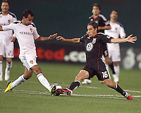 Josh Wolfe (16) of D.C. United  and Juninho (19) of the Los Angeles Galaxy go for a loose ball during an MLS match at RFK Stadium, on April 9 2011, in Washington D.C.The game ended in a 1-1 tie.