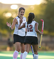 STANFORD, CA - September 3, 2010: Becky Dru (8) and Alysha Sekhon (12) during a field hockey match against UC Davis in Stanford, California. Stanford won 3-1.