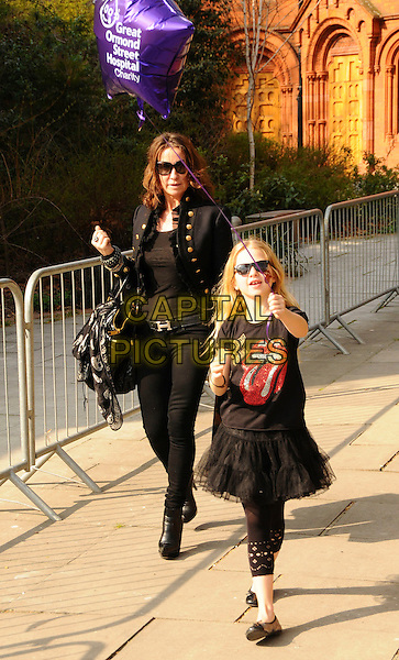 "MEG MATTHEWS & DAUGHTER ANAIS GALLAGHER .At the 2nd ""Mummy Rocks"" Fundraising event, The Tabemrche, powis Square, London, England, UK, March 21st 2009..biker leggings lace trim full length military jacket black skinny jeans bag skull print scarf sunglasses boots hermes belt purple balloon tutu skirt ballet flats shoes pumps mouth rolling stones t-shirt top family mother child .CAP/CAS.©Bob Cass/Capital Pictures"